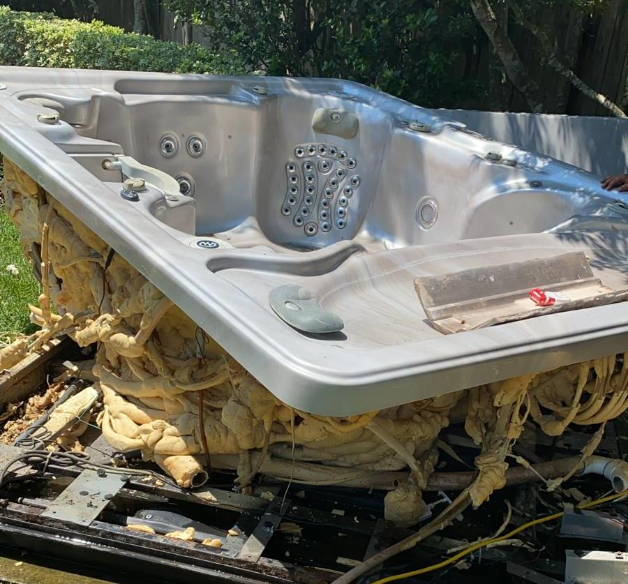 image of hot tub being removed